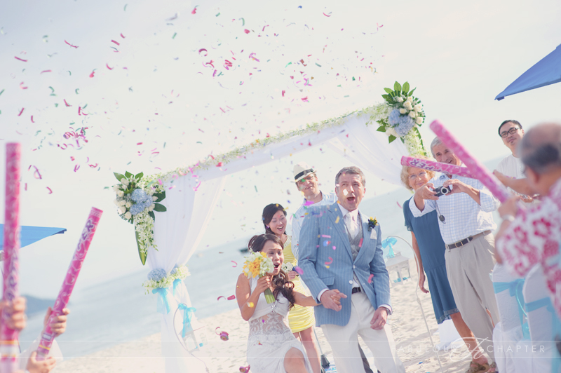 Jasmine & Mathias marching out from their beach wedding