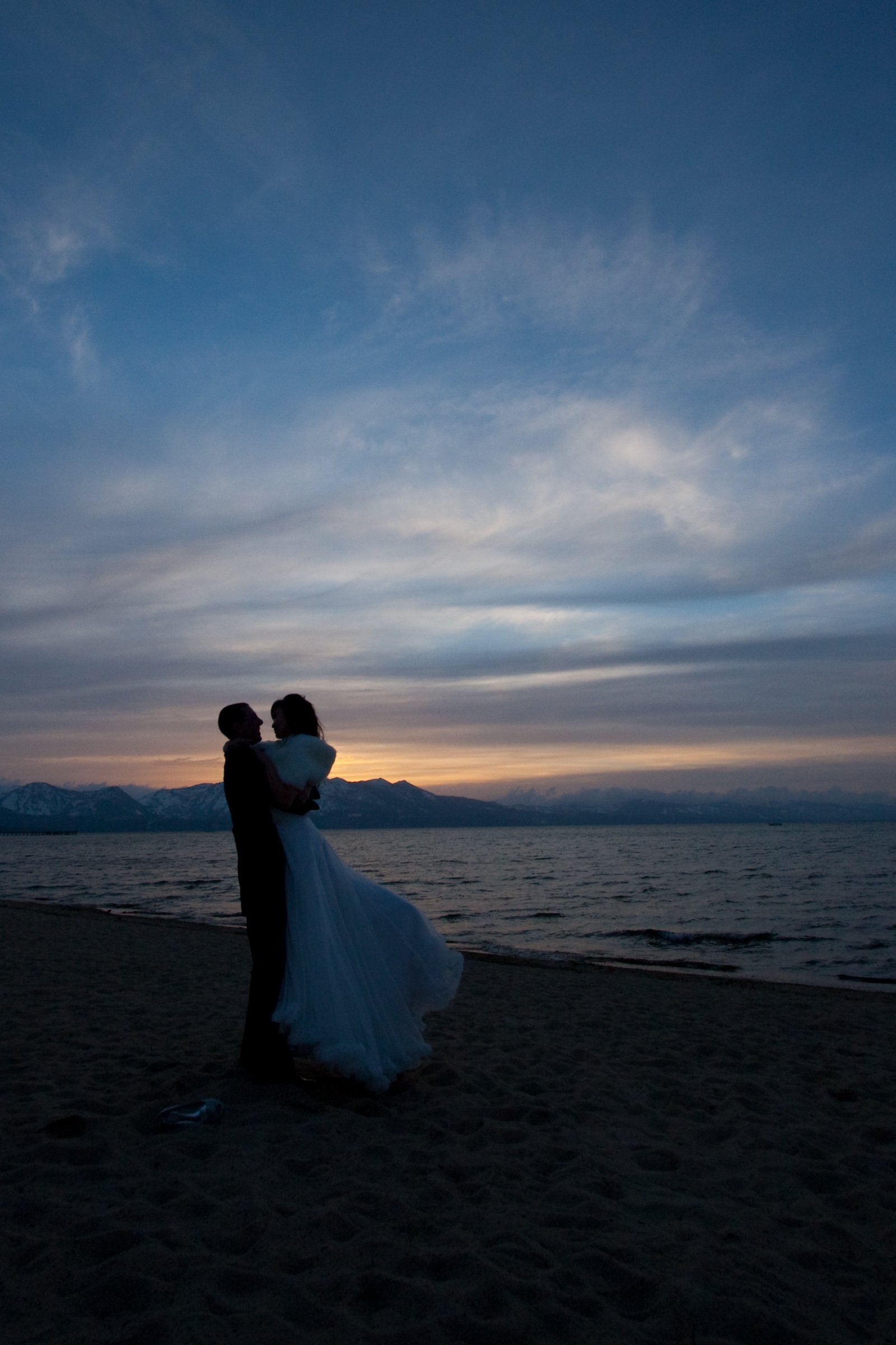 Celeste and Jeff wedding portrait showing their silhouette against evening sky