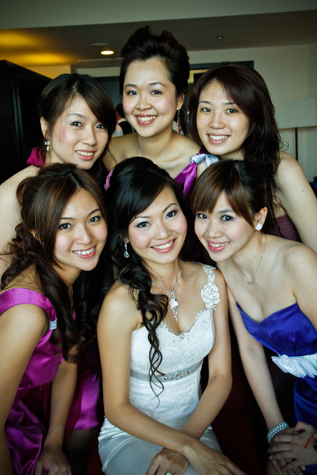 Celeste and her bridesmaids in purple theme wedding reception