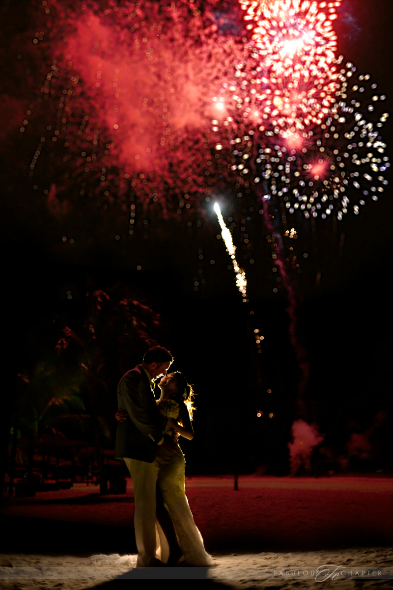 Jasmine & Mathias with fireworks background during beach dinner reception